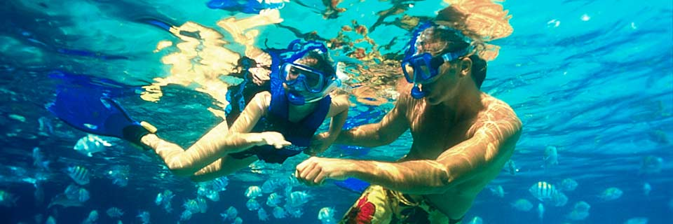 Couple snorkeling in Caribbean adventure