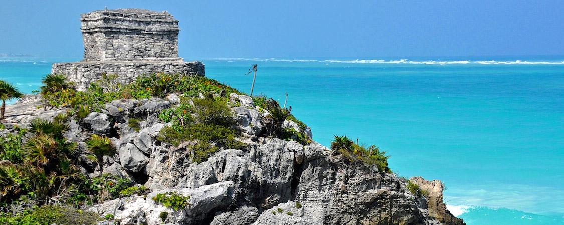 Mayan ruins on crystal ocean of Tulum adventure